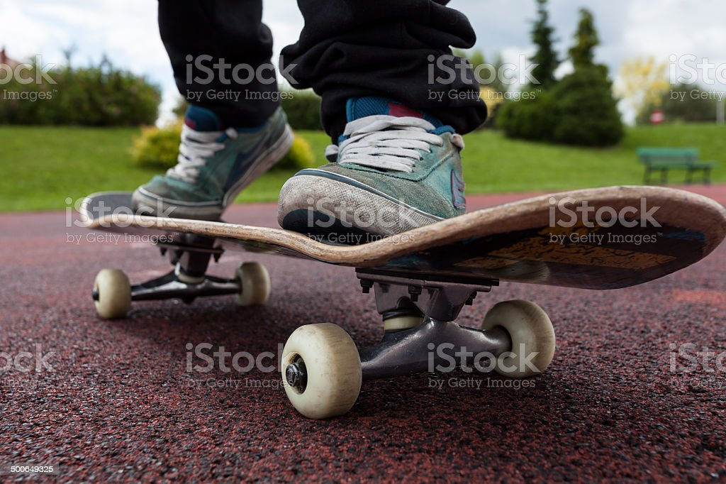 Young person rides on skateboard stock photo