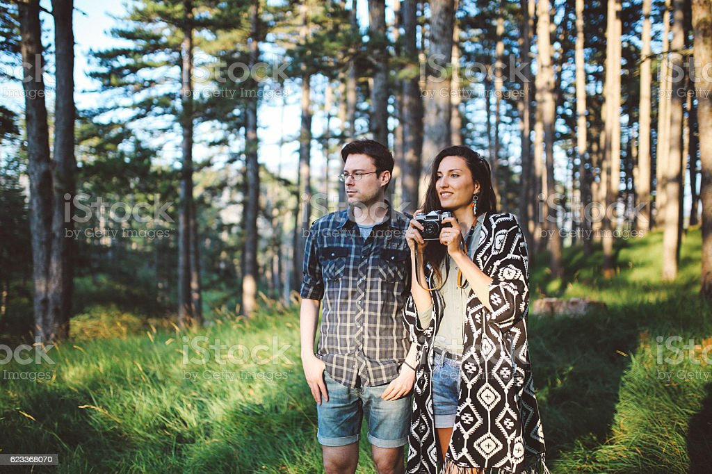 Young photographer couple camping stock photo