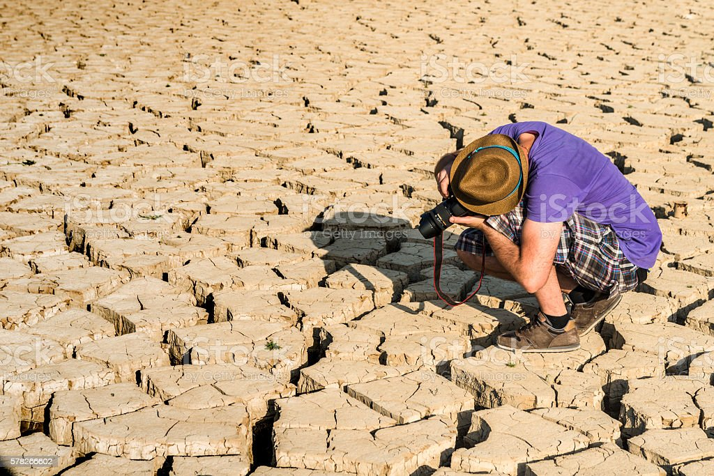 Young photographer in a desert stock photo