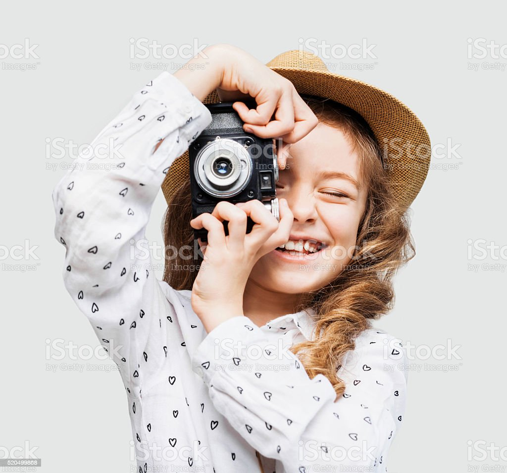 Young photographer looking at camera stock photo
