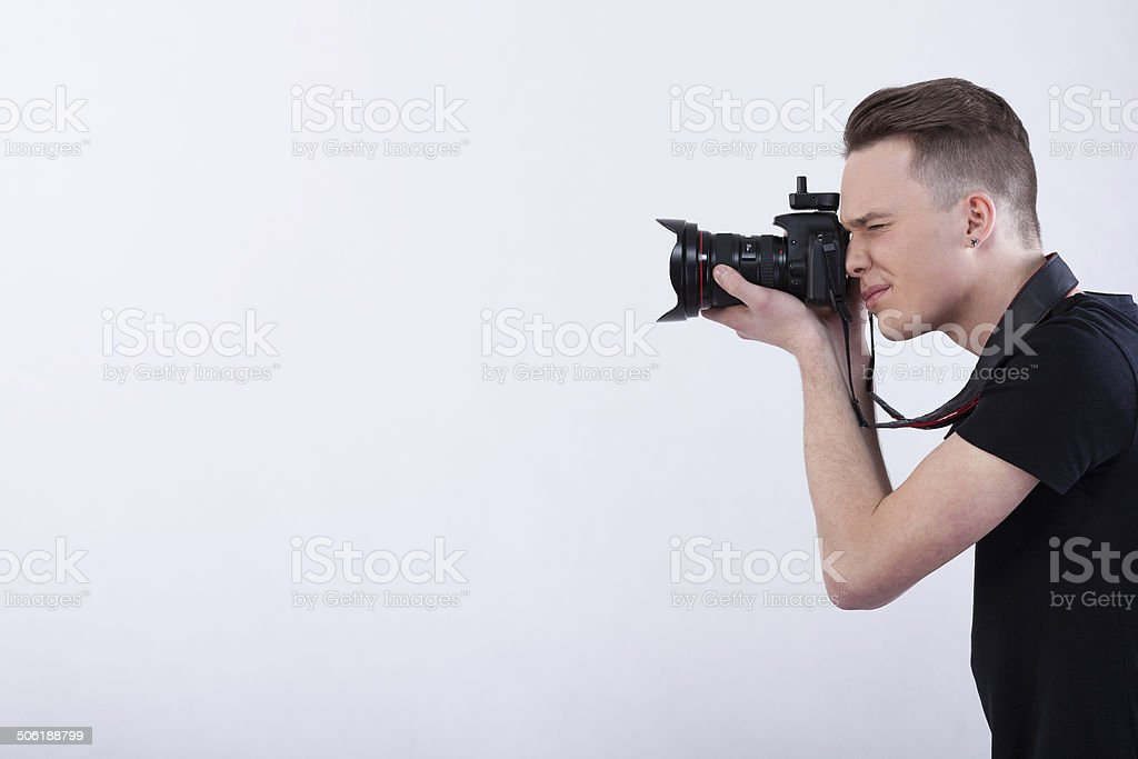 Young photographer on isolated white background stock photo