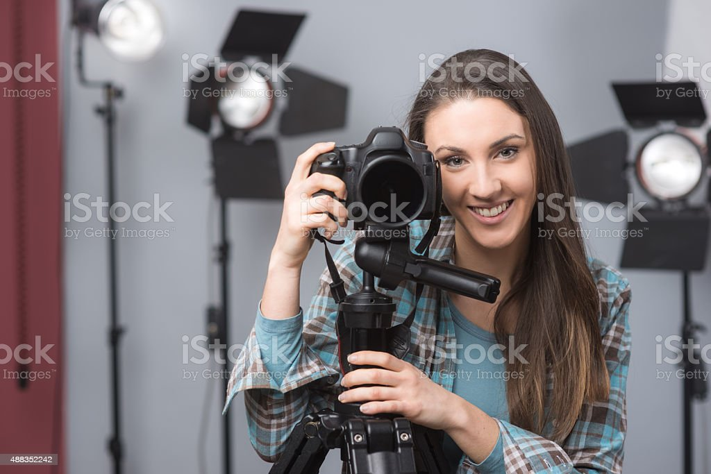 Young photographer posing stock photo