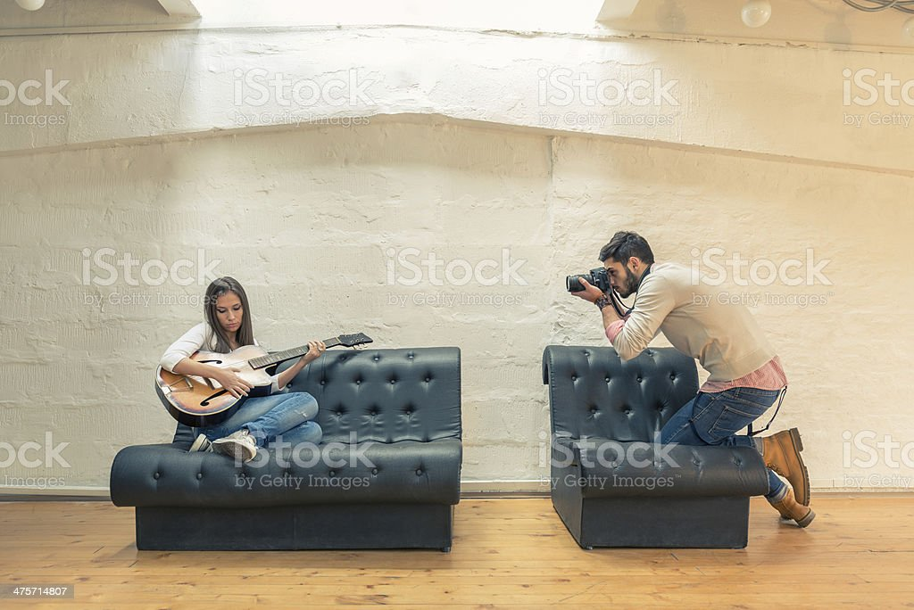 Young photographer taking photos in studio royalty-free stock photo