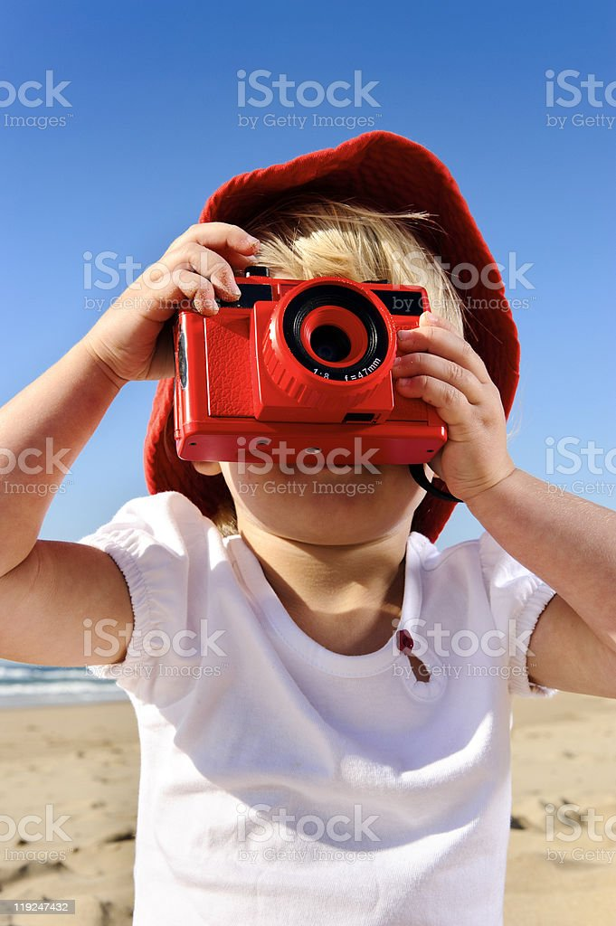 Young photographer with bright red camera stock photo
