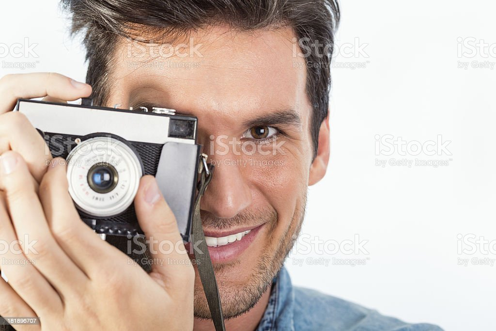 Young photographer with old-fashioned camera royalty-free stock photo