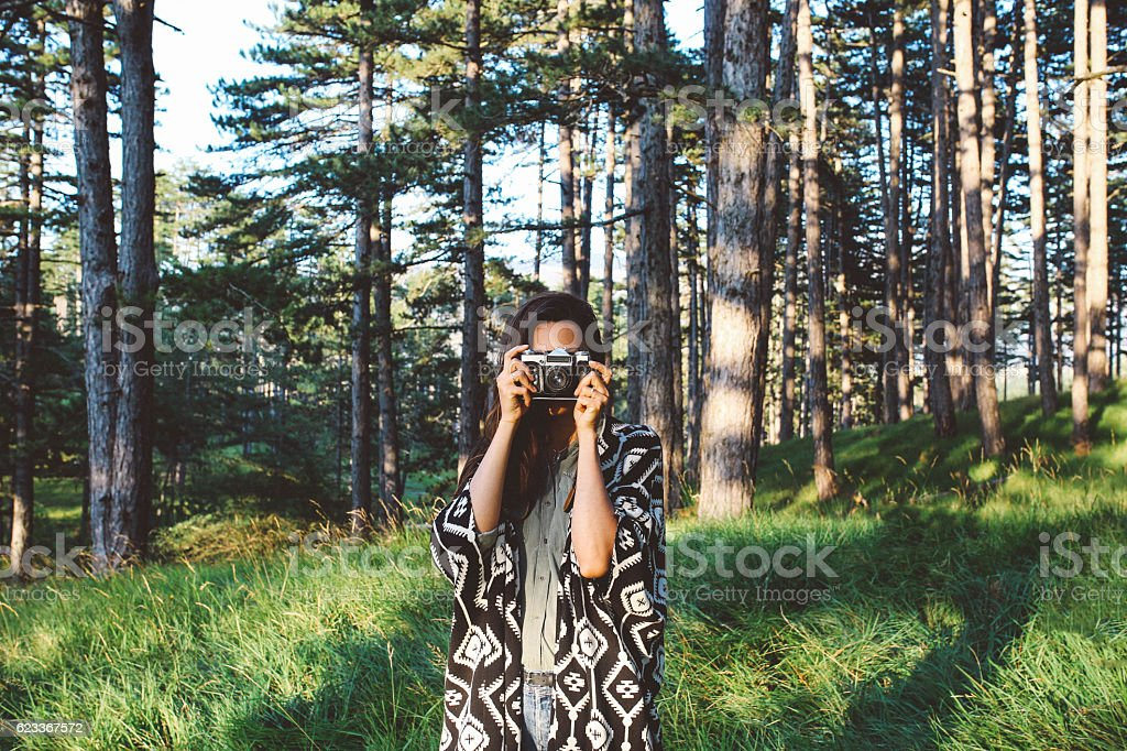 Young photographer woman in the woods stock photo