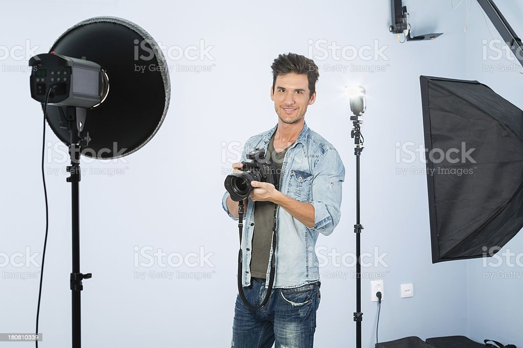 Young Photographer Working in Studio royalty-free stock photo