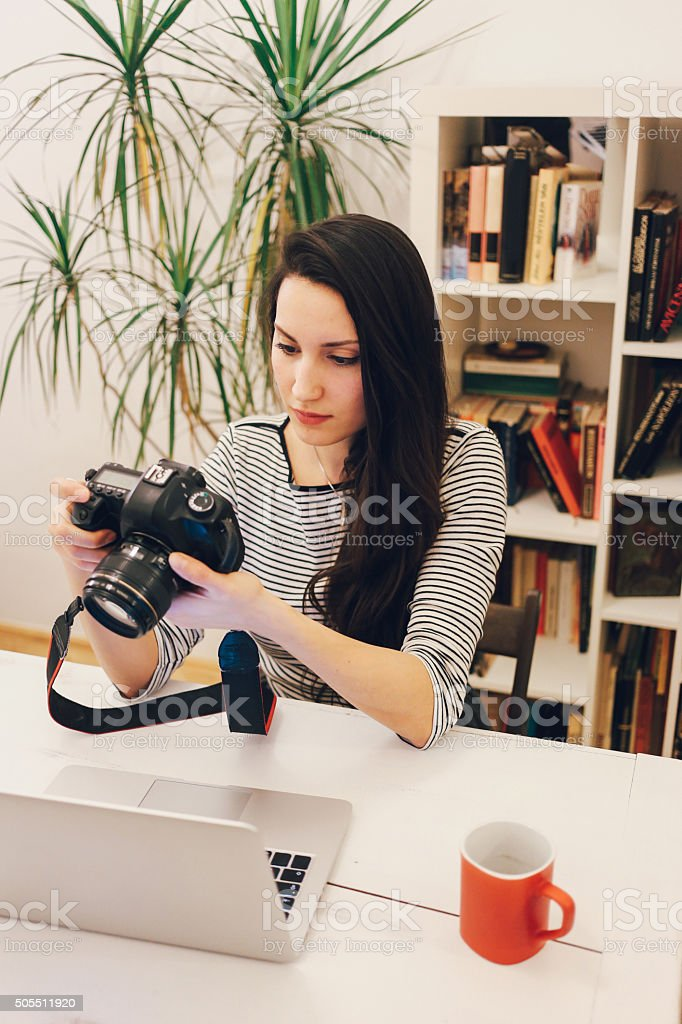 Young photographer working on the laptop stock photo