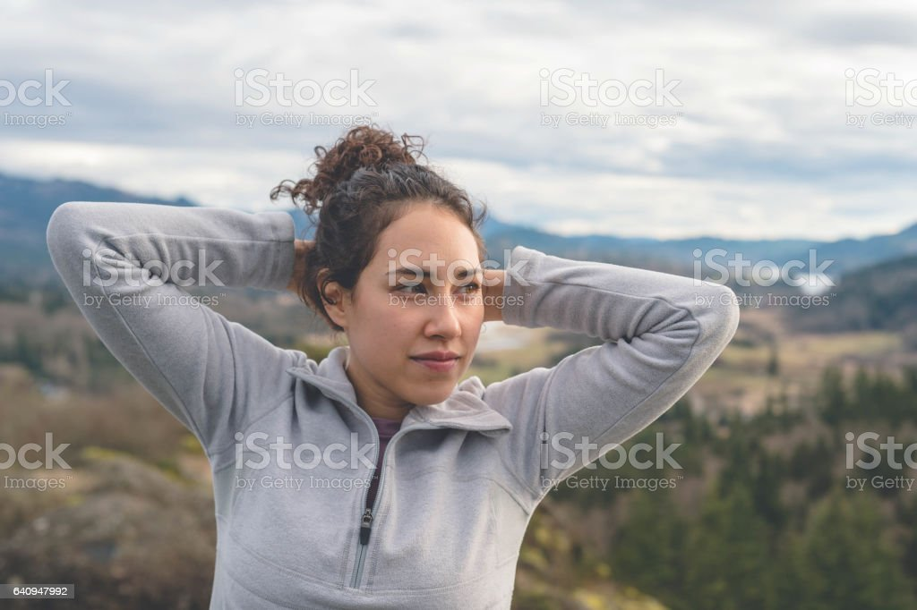 Young physically fit woman hiking by herself stock photo
