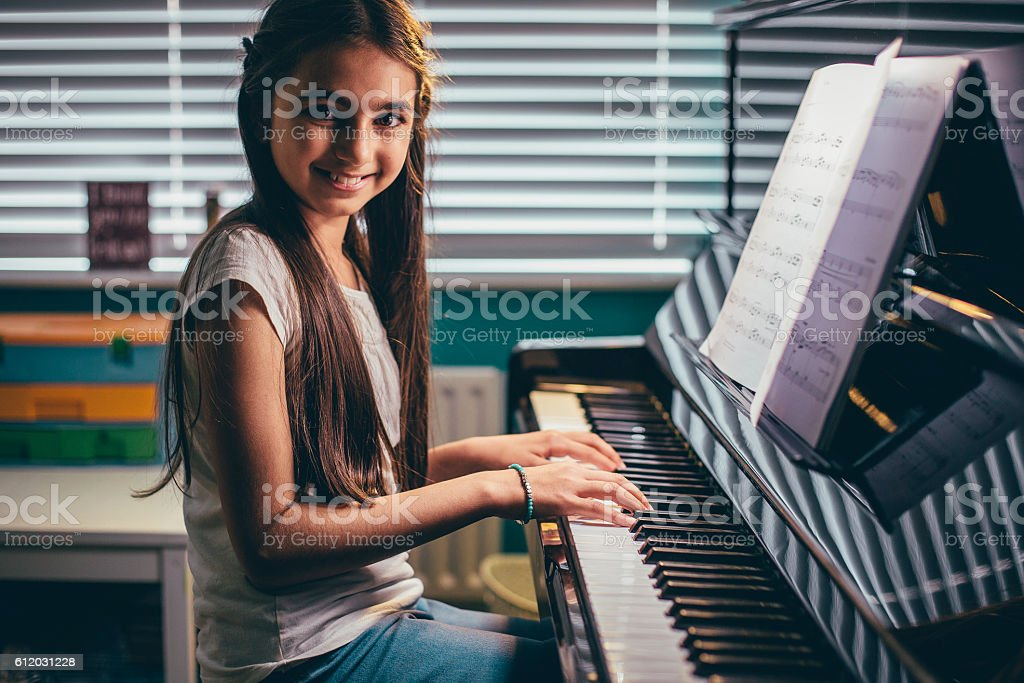 Young Pianist at Home stock photo