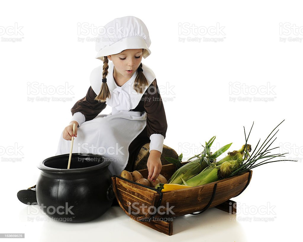 Young Pilgrim Cooking royalty-free stock photo