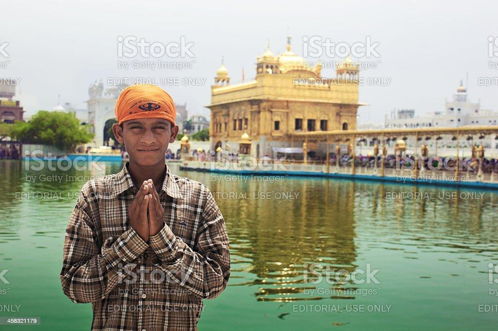 Young pilgrim in Golden Temple stock photo