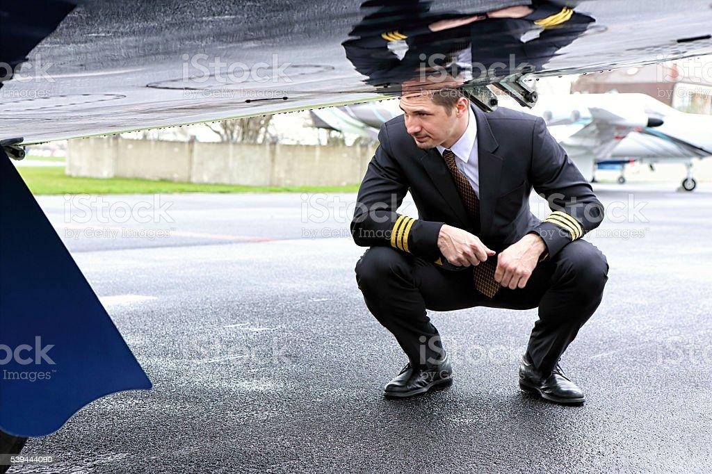 Young pilot checking main gear stock photo