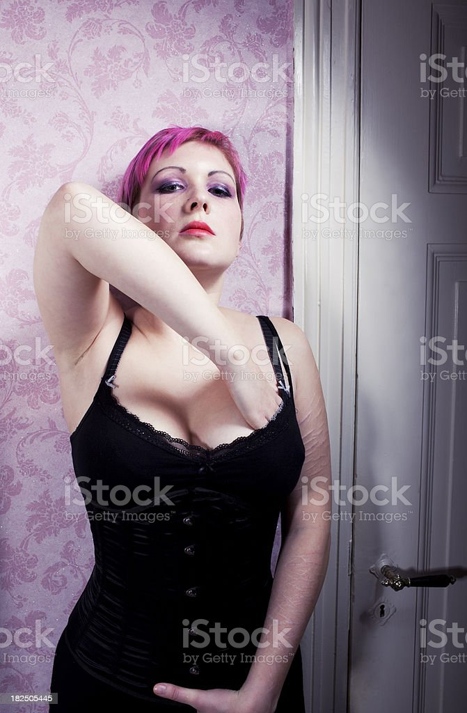 young pink hair woman, many scars on her arm stock photo