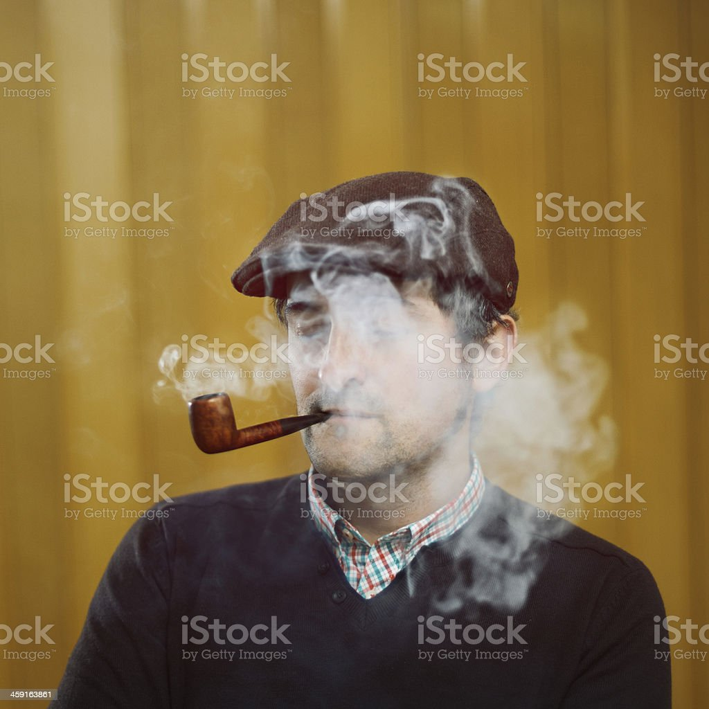 Young pipe smoker stock photo