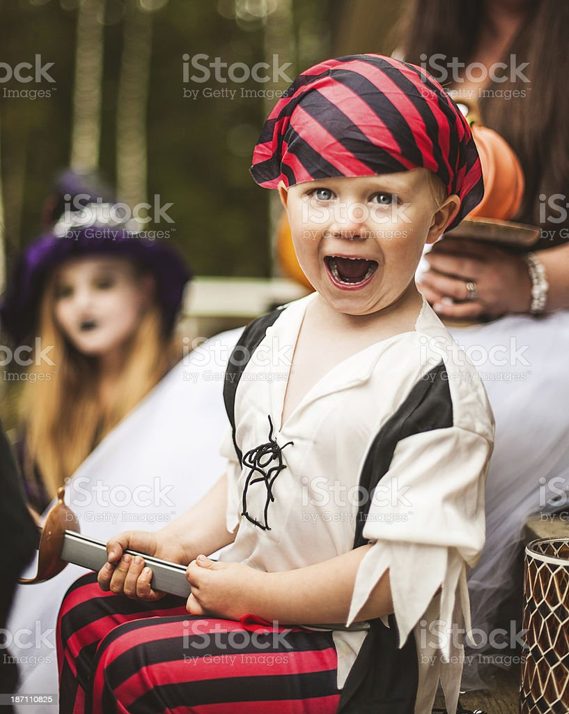 Young pirate and family dressed up for halloween royalty-free stock photo