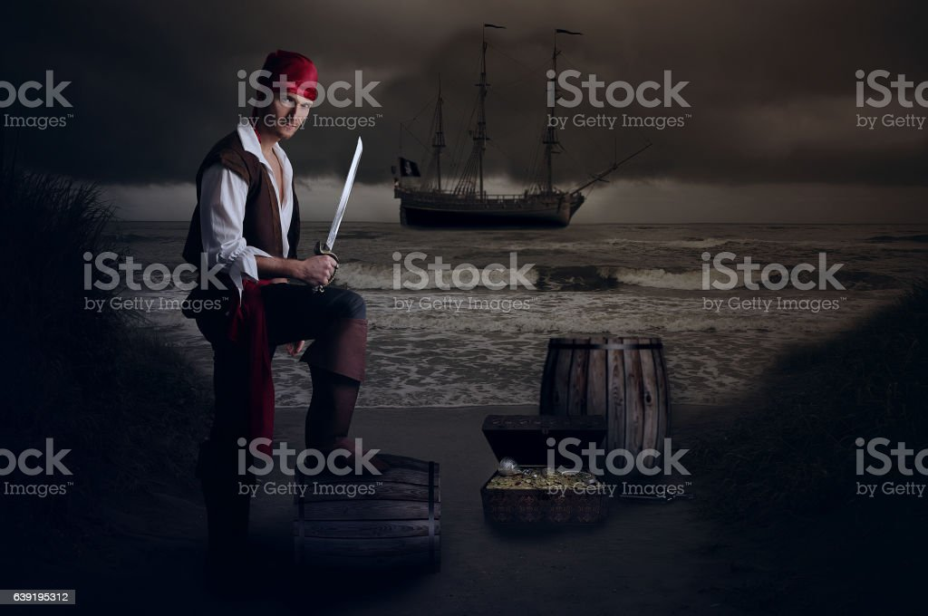 Young pirate posing on a barrel stock photo