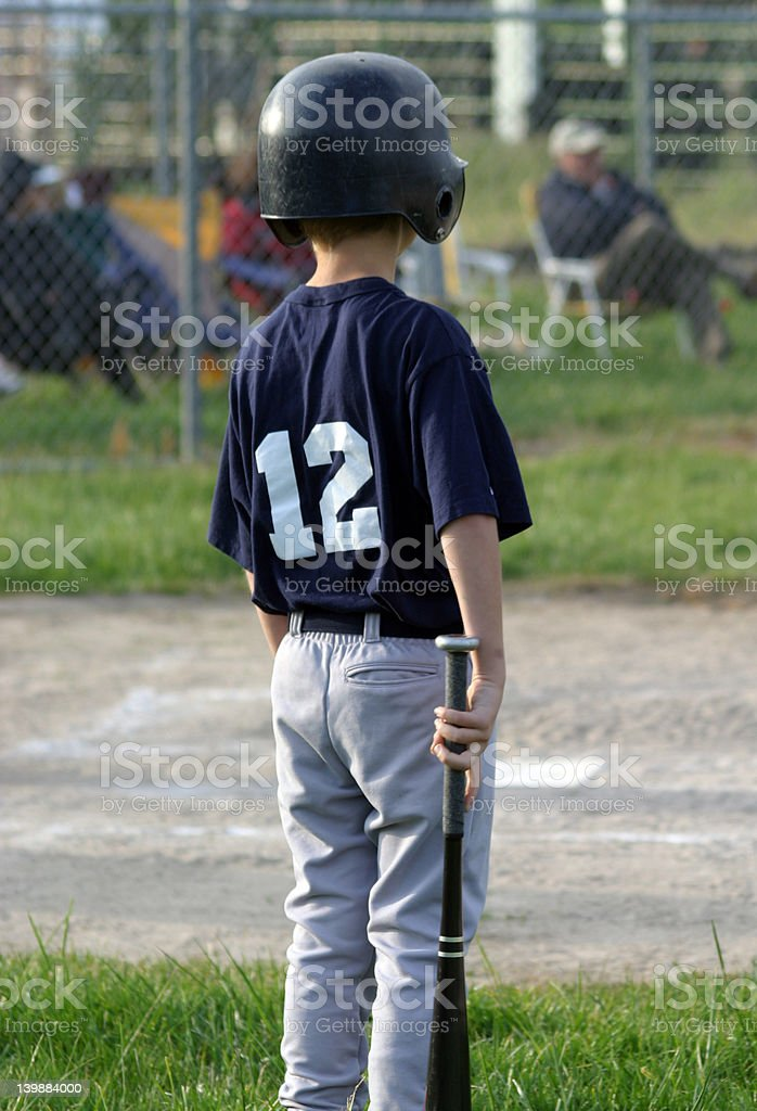 Young Player Waiting to Bat royalty-free stock photo