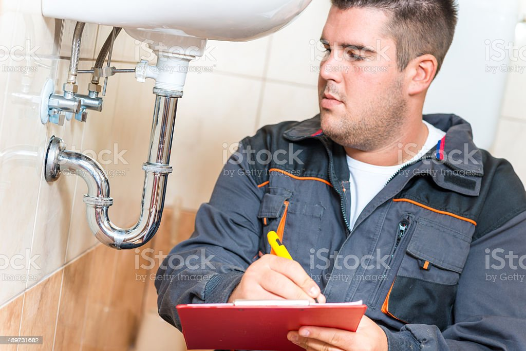 Young Plumber With Clip Board stock photo