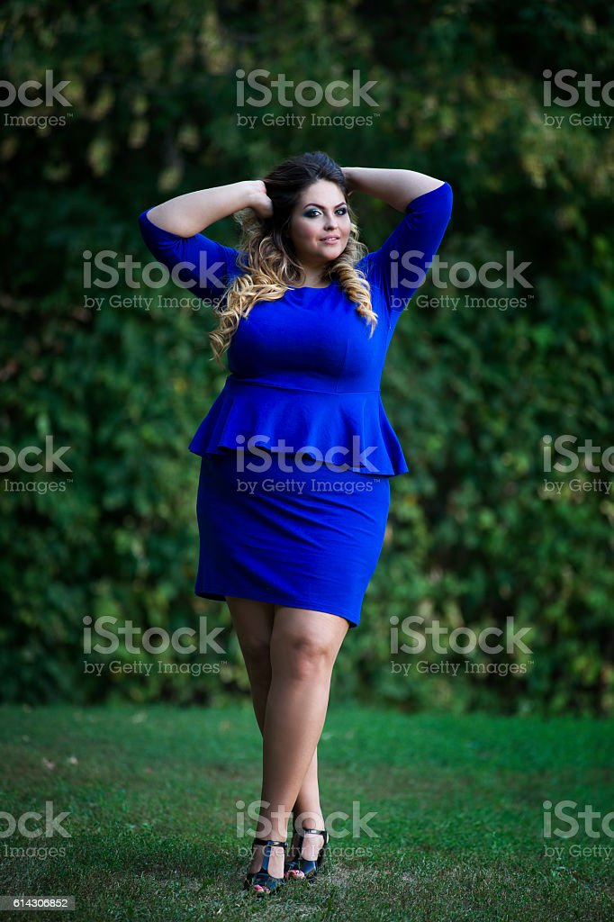 Young plus size fashion model outdoors, xxl woman on nature stock photo
