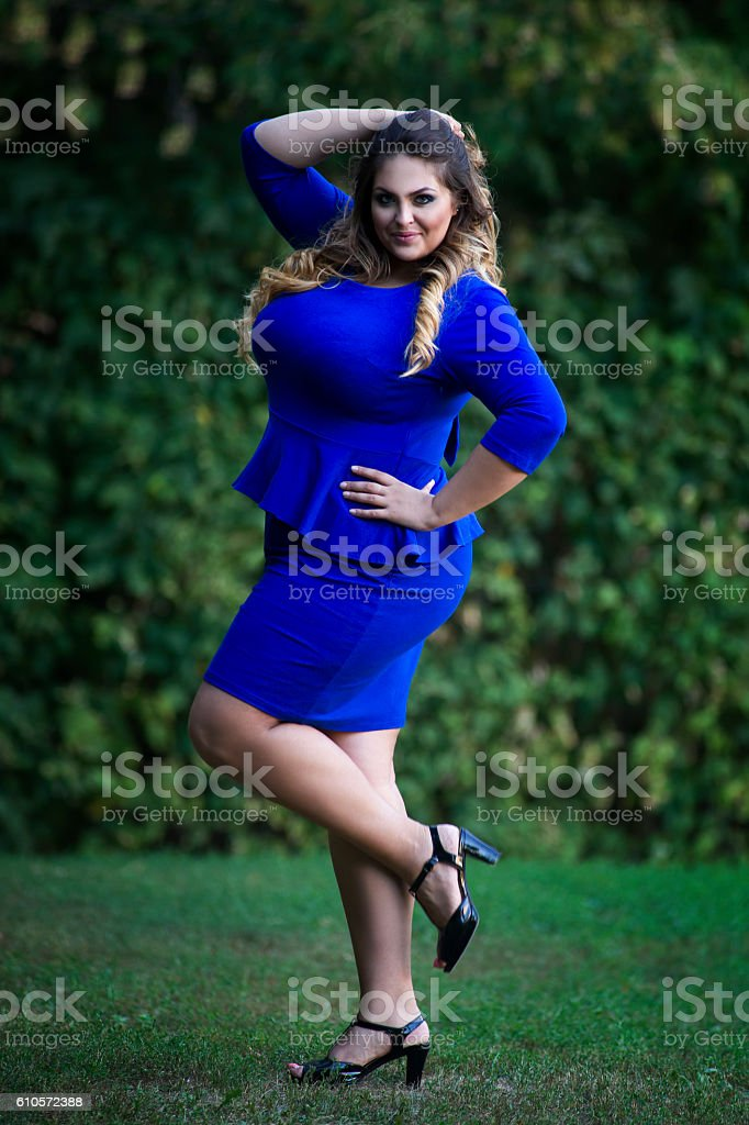 Young plus size model outdoors, xxl woman on nature stock photo