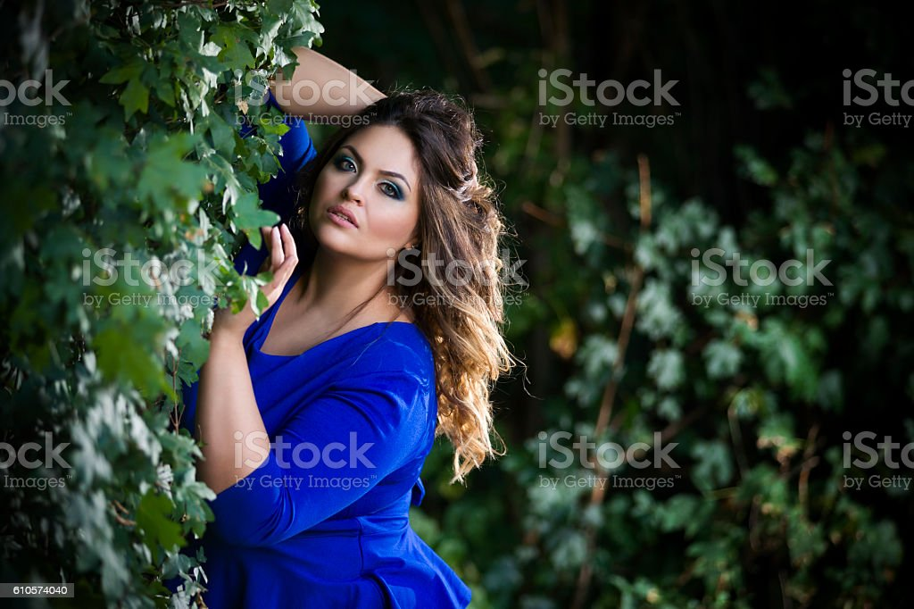 Young  plus size model  outdoors, xxl woman stock photo