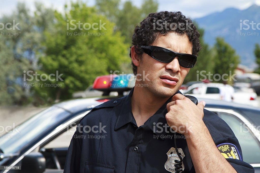 Young Police Officer Standing By His car royalty-free stock photo