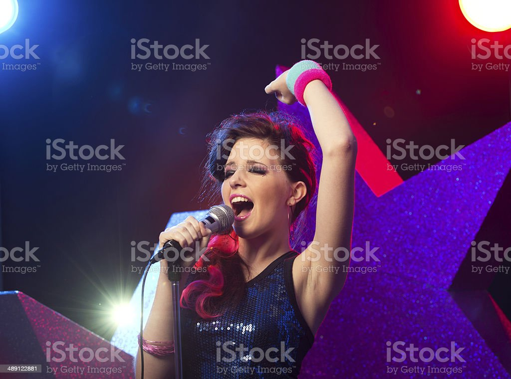 Young pop star performing stock photo