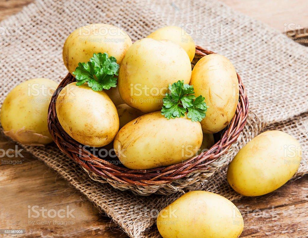 Young potatoes basket stock photo
