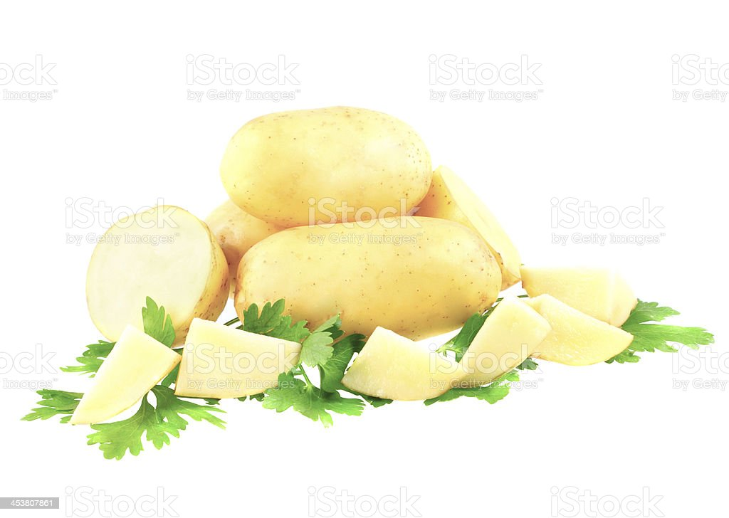 Young potatoes, decorating of parsley . Isolated stock photo