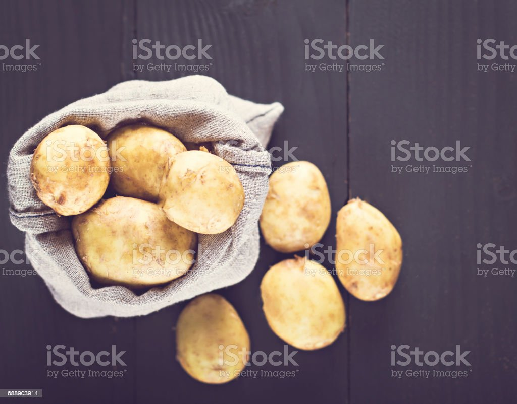 Young potatoes in a bag stock photo
