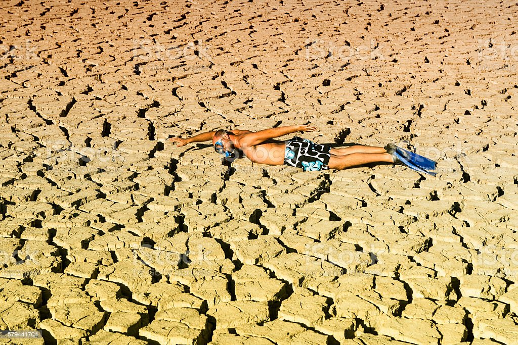young practicing diving in a dry swamp stock photo