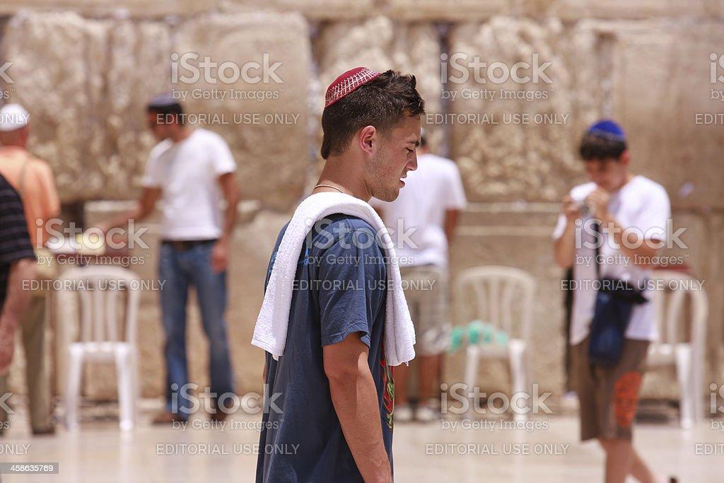 Young prayer walking at the Western wall royalty-free stock photo