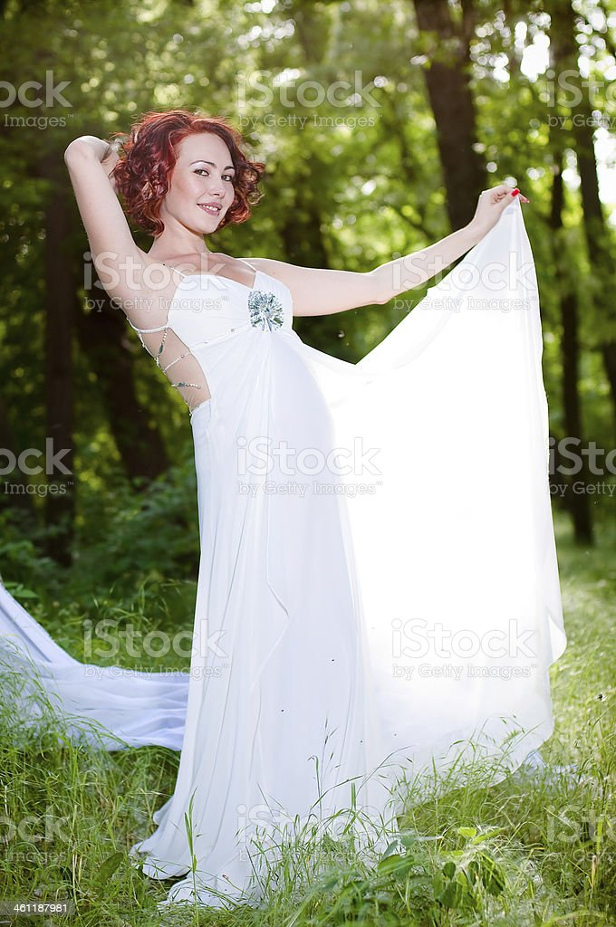 Young pregnant woman in white dress stock photo