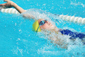 Young Preteen Female Athlete Swimming Backstroke