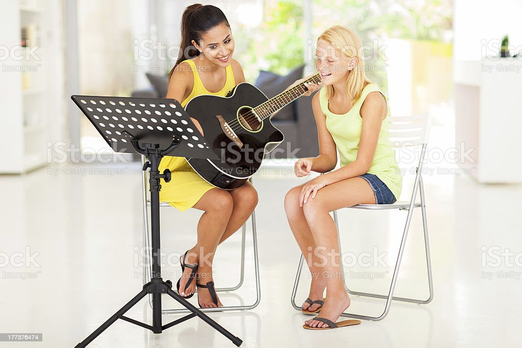 young preteen girl having guitar lesson royalty-free stock photo