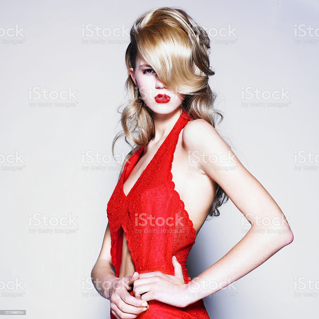 Young pretty blond woman in a fashionable red dress royalty-free stock photo