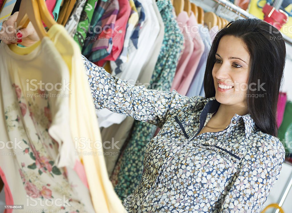 Young pretty brunette shopping stock photo