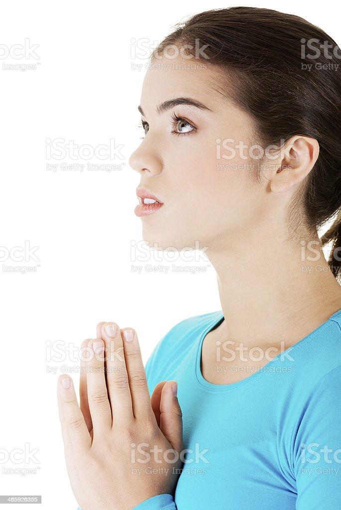 Young pretty caucasian girl praying royalty-free stock photo