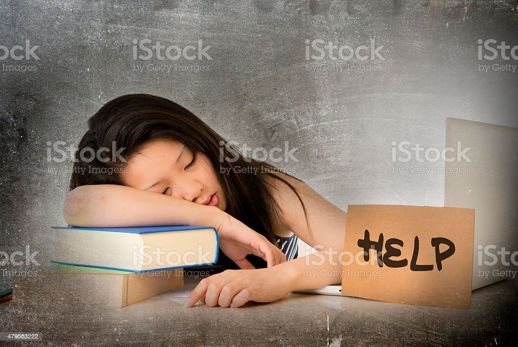 young pretty chinese asian student girl tired and overworked stock photo