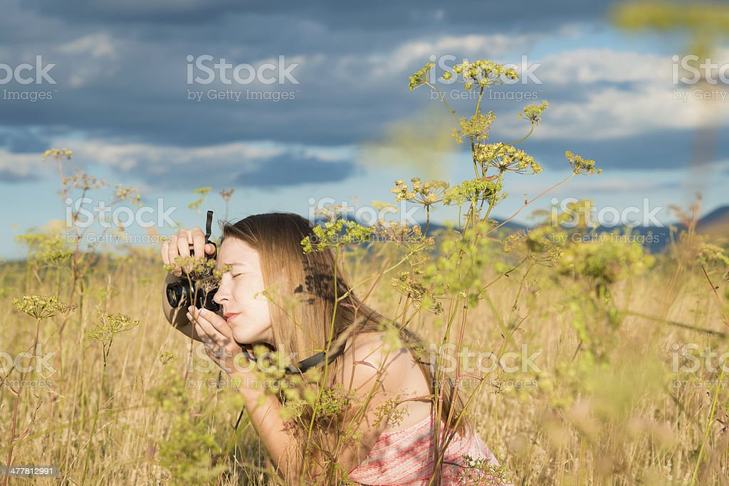 Young Pretty Female Photographer in Meadow royalty-free stock photo