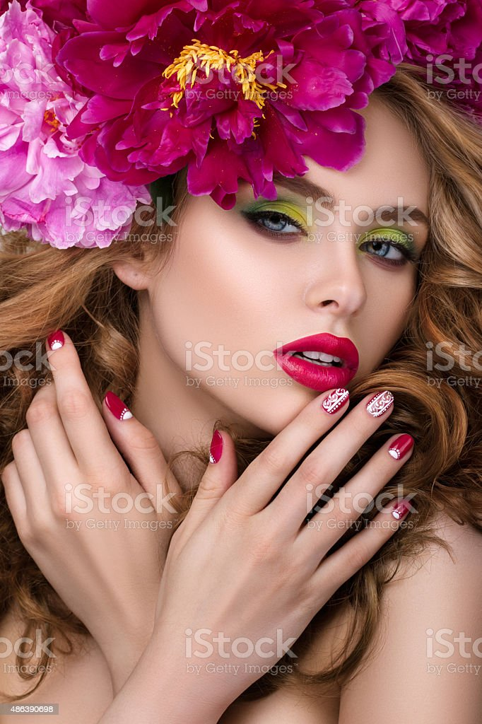 Young pretty girl with flower wreath stock photo