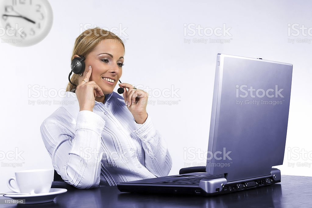 Young pretty operator talking to a costumer royalty-free stock photo