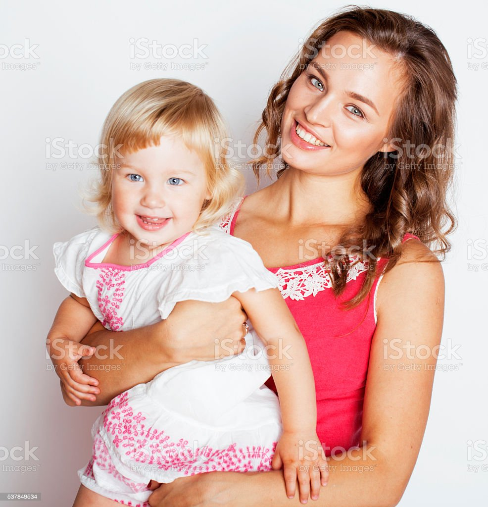 young pretty stylish mother with little cute daughter hugging, happy stock photo