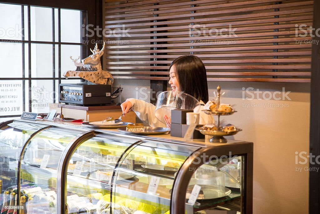 Young Pretty Waitress at  Japanese cafe restrant in Tokyo stock photo