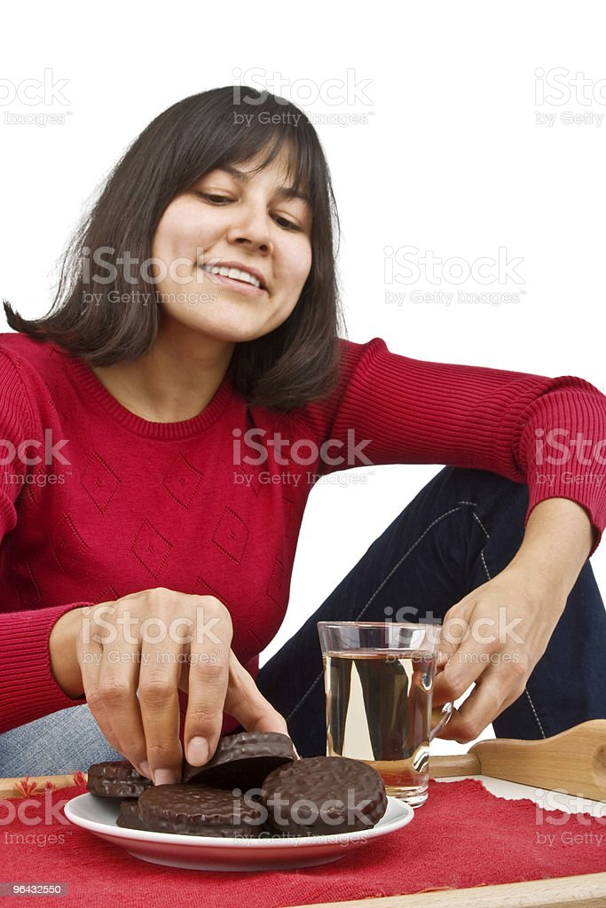 Young pretty woman drinking tea. Focus on hand. royalty-free stock photo