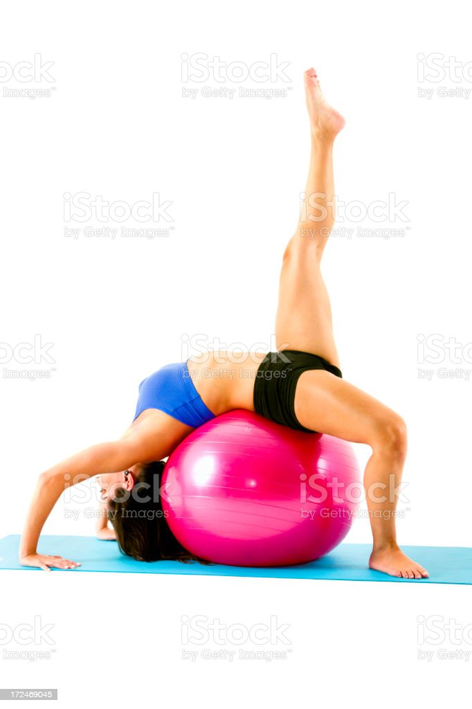 Young pretty woman exercising with fittness ball in pilates workout royalty-free stock photo