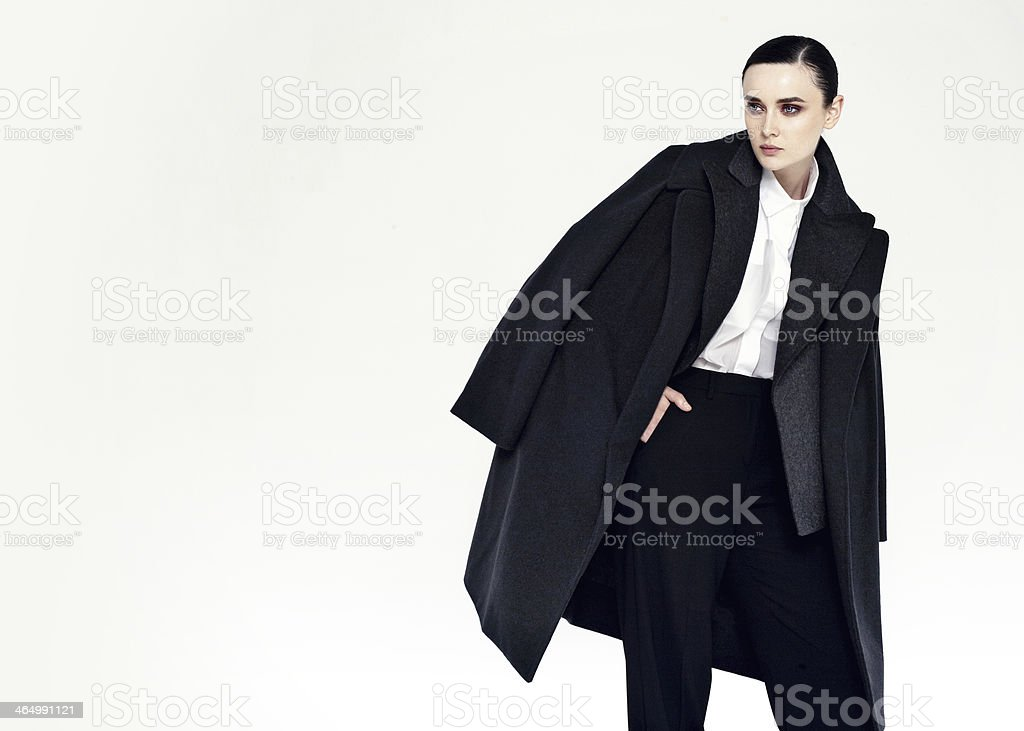 young pretty woman in black coat stock photo