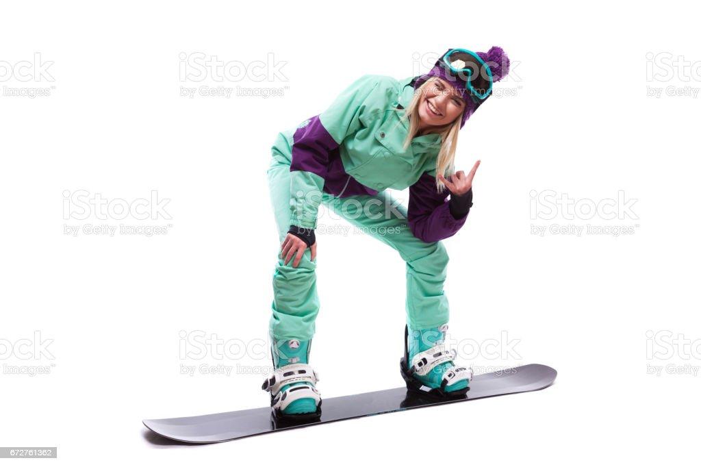 young pretty woman in purple ski costume ride snowboard stock photo