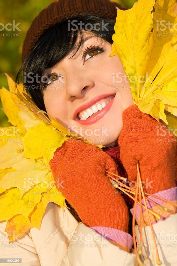 Young pretty woman on the autumn leaf royalty-free stock photo